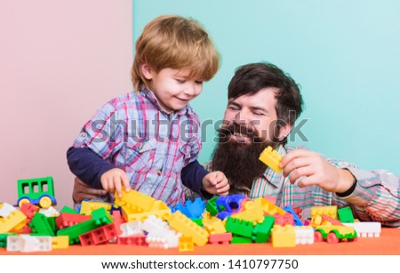My family is my inspiration. happy family leisure. love. child development. building with constructor. father and son play game. small boy with dad playing together. free time. free time together.