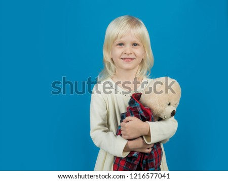 My funny friend. Little girl with teddy bear. Small girl hold toy bear. Little child with soft toy. Small kid happy smiling. My favorite childhood toy. Happy childhood, copy space.