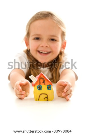 My home is protected - insurance concept with happy girl shielding her clay model house - stock photo