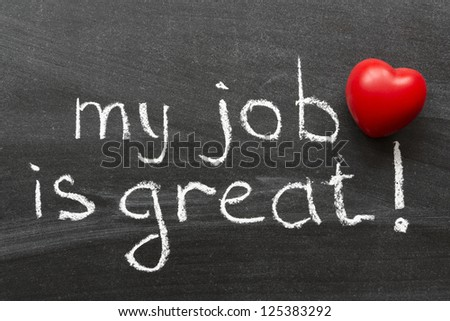 my job is great -  positive concept phrase handwritten on black chalkboard with volume red heart symbol