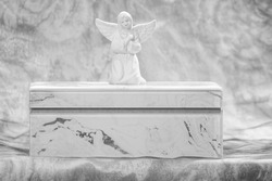 My mother my angel A beautiful white and gold funeral urn with an angel figurine on top in black and white