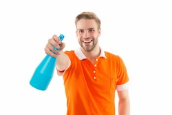 My reputation is spotless. Happy guy spray household cleaner. Handsome man hold bottle with household cleaning product. Enjoying household activities. Household hygiene. For all cleaning needs.