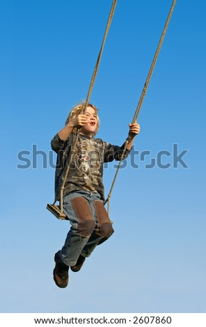 My son on the swing. - stock photo