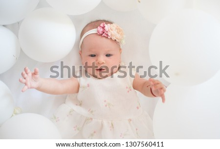 My sweet baby. Family. Child care. Childrens day. Small girl. Happy birthday. Childhood happiness. Portrait of happy little child in white balloons. Sweet little baby. New life and birth.