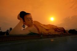 Mya Tha Lyaung Reclining Buddha  in the sunset. Bago, Myanmar.