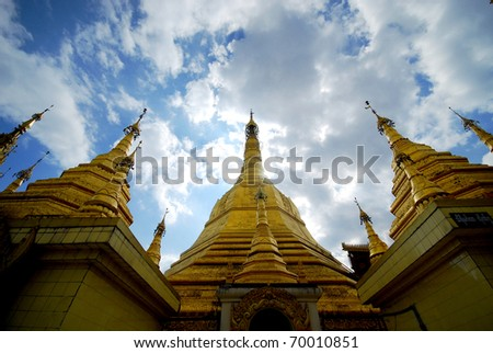 Myanmar gold pagoda in Yangon with blue sky