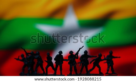 Myanmar military coup soldiers, flag map background  Photo stock ©