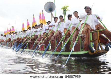 MYANMAR-OCTOBER12: Boat race in the Phaung Daw Oo festival. October 12, 2010, Inle lake, Myanmar. Phaung Daw Oo, the one of biggest festivals at Inle lake.