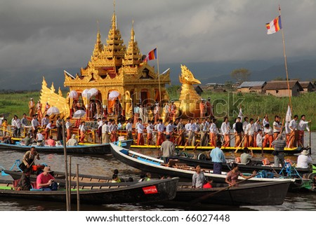 MYANMAR-OCTOBER 12: The gold swan boats and local boats follow the procession, Phaungdawoo festival on October 12 2010 Inle lake Myanmar. The festival is the one of the biggest festivals in Inle lake