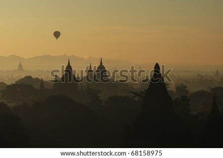Myanmar sightseeing: Balloon rider over Bagan temples at sunrise