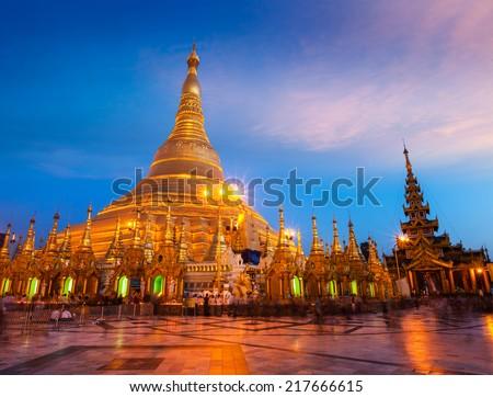 Myanmer famous sacred place and tourist attraction landmark - Shwedagon Paya pagoda illuminated in the evening. Yangon, Myanmar (Burma)