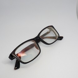 Myopic glasses that are no longer used, with black frames and a mildew coating on the lenses.