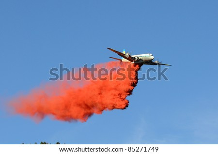 MYRTLE CREEK, OREGON - SEPTEMBER 18: Large air tanker drops fire retardant at a natural cover fire near Myrtle Creek, OR, USA on September 18, 2011