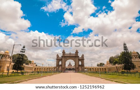 MYSORE PALACE . one of the best monumental places . the sky and the palace perfectly blends as it gives a royal look . symmetric and perfect composition. #1252196962