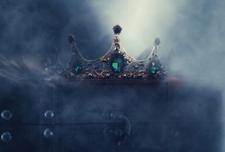 mysterious and magical photo of of beautiful queen/king crown over gothic dark background. Medieval period concept