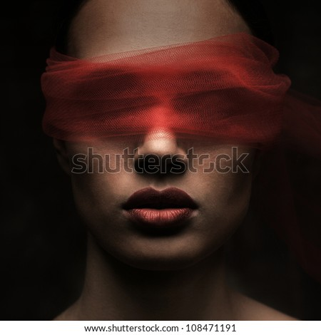 Stock Photo Mysterious beautiful face with ribbon on eyes