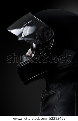 Mysterious biker in a dark environment, Clipping path included.