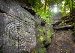 Mysterious labyrinth carvings on the rocks in Rocky Valley , North Cornwall, England, UK could be 400 years old