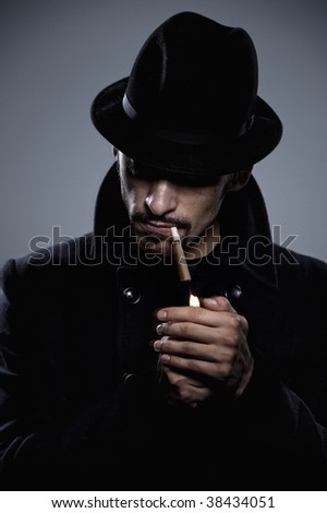 Mysterious man lighting a cigarette