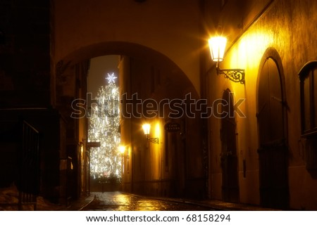 mysterious narrow alley with christmas tree in Prague