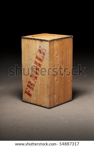 "Mysterious old wooden crate with word ""Fragile"" . - stock photo"