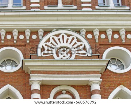 Mysterious symbols on the facade of the palace of Catherine the Great in Tsaritsyno. Architect Bazhenov. May 2014, Moscow, Russia. #660578992