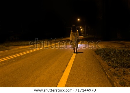Stock Photo Mysterious Woman, Horror scene of scary ghost woman standing outdoor on street with light