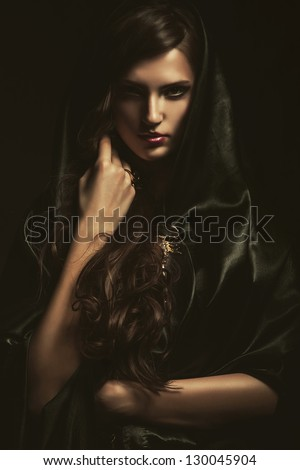mysterious woman in black cape