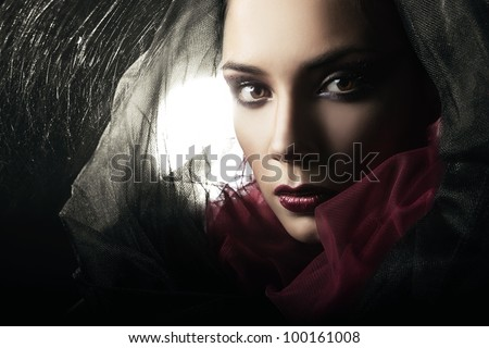 Stock Photo mysterious woman in black hood and web