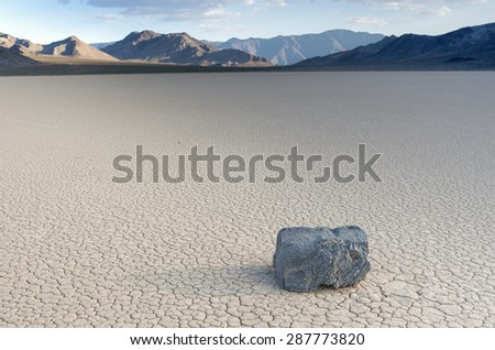 Mysteriously Moving Stones and its Long Traces at The Racetrack Playa in Death Valley National Park, California. Horizontal Image Composition