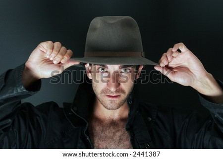 Mystery man with hat portrait - stock photo