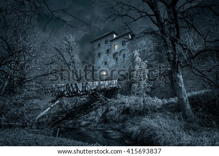 Stock Photo Mystic castle in the night with moat