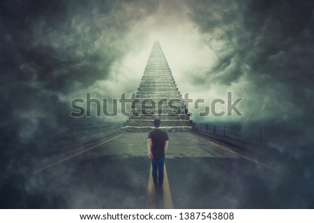 Mystic scene, wanderer guy confident walking a surreal road and found a magic stairway going up to a door in the sky. Freedom of choice concept. Opportunity stair, way to failure or success. ストックフォト ©