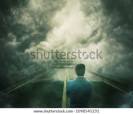 Mystic view as a man stand on the road transforming into a stairway going up to unknown heaven. Difficult decision, concept of the important choice. Opportunity staircase, way to failure or success. ストックフォト ©