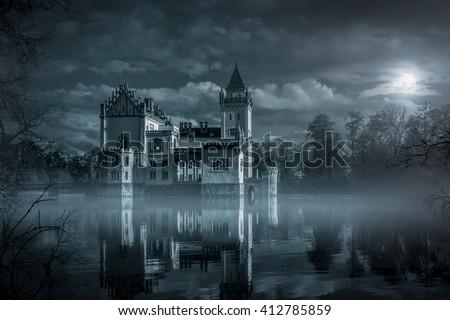 Stock Photo Mystic Water castle in moonlight