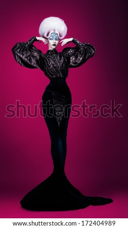 mystic woman in long dress and wig