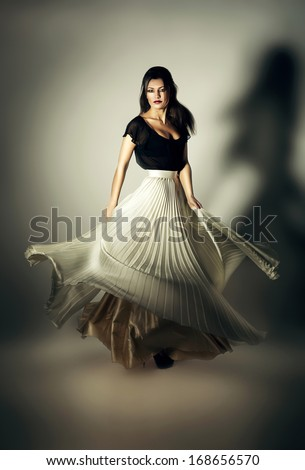 mystic woman with flying white skirt