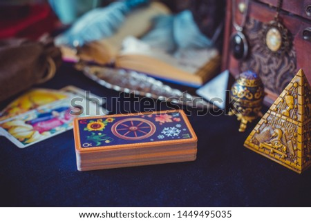 Mystical atmosphere, view of tarot card on the table, esoteric concept, fortune telling and predictions
