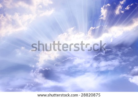 mystical blue sky with divine rays of light