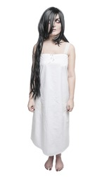 Mystical ghost woman in white long shirt isolated