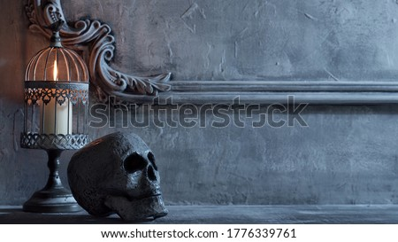 Mystical Halloween still-life background. Skull, candlestick with candles, old fireplace. Horror and witchery. Zdjęcia stock ©