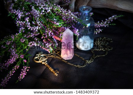 Mystical still life with a magic key and Heather