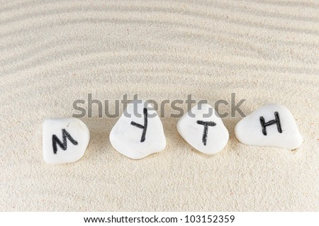 Myth word on group of stones with sand as background