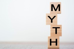 Myth word on wooden cubes with copy space
