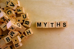 Myths word cube on wood background ,English language learning concept