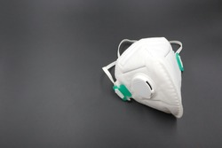 N 95 respirator dust mask for protect PM 2.5 White medical mask isolated. Face mask protection against pollution, virus, flu and covid19   A dark background