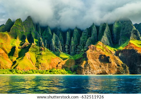 Na Pali coast, Kauai, Hawaii view from sea sunset cruise tour. Nature coastline landscape in Kauai island, Hawaii, USA. Hawaii travel. #632511926
