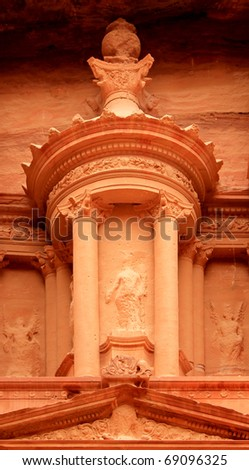 """Nabatean architecture detail of """"The treasury"""" at Petra, Lost rock city of Jordan. Petra's temples, tombs, theaters and other buildings are scattered over 400 square miles. UNESCO world heritage site"""