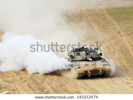 NACHAL OZ, ISR - NOV 12:Merkava patrols along Gaza on NOV 12 2008.It's IDF battle tank designed for rapid repair of battle damage, survivability, cost-effectiveness and off-road performance.