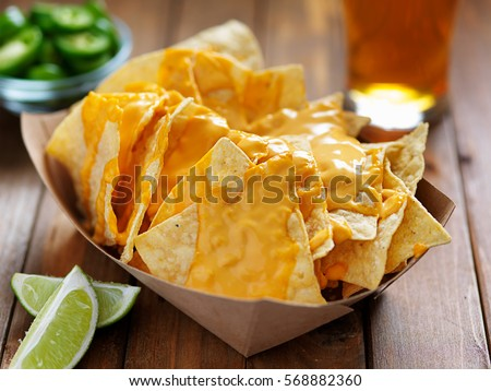 nachos and cheese with lime shot with selective focus Foto stock ©